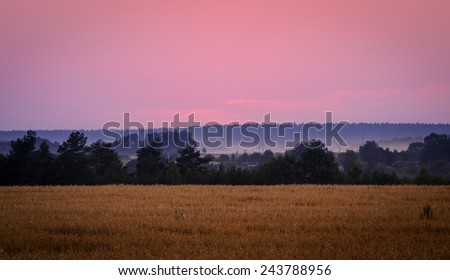 sunset over the rural landscape - stock photo