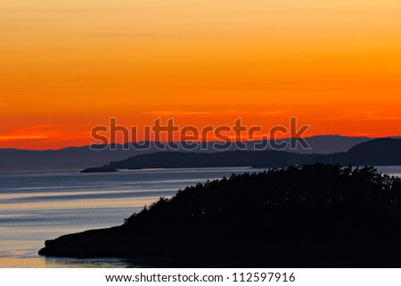 Sunset over the San Juan Islands in the Puget Sound - stock photo