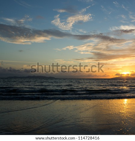 Sunset over the sea and beach