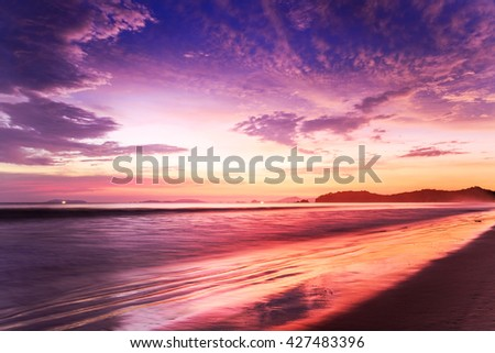 Sunset over the sea with beautiful sky - stock photo