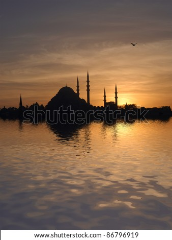 Sunset over the Suleymaniye mosque in Istanbul, Turkey, at sunset - stock photo