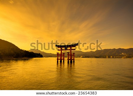 Sunset over the Unesco world heritage shrine in Miyajima, Hiroshima, Japan - stock photo