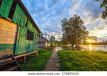Sunset over the village of Santa Rita in the Amazon rainforest in Peru - stock photo