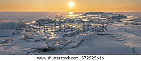sunset over the winter sea panorama - stock photo