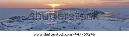 sunset over the winter sea panorama - stock photo