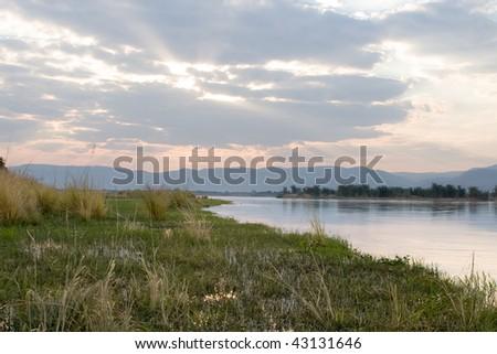 Sunset over the Zambezi river - stock photo