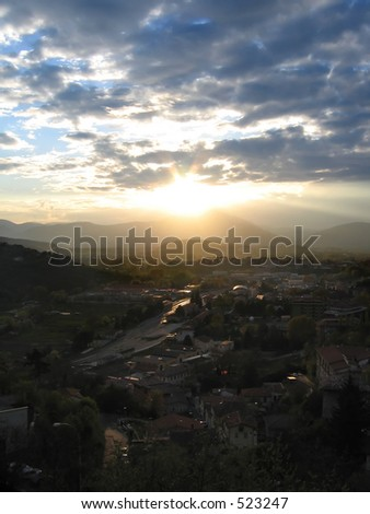Sunset over town of L'Aquila, Italy - stock photo