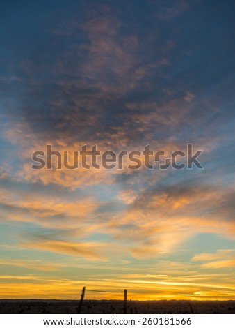 Sunset over U.S. Route 82 in New Mexico in December. - stock photo