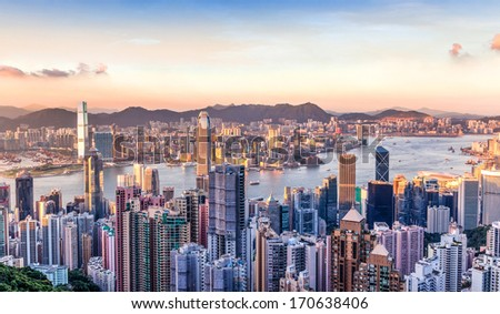 Sunset over Victoria Harbor as viewed atop Victoria Peak - stock photo