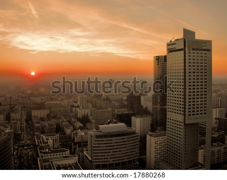 Sunset over Warsaw downtown - aerial view from the top of the Palace of Culture and Science. - stock photo