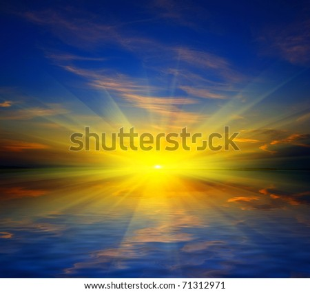 Sunset over water surface of lake - stock photo