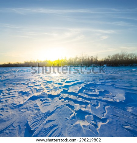 sunset over winter fields - stock photo
