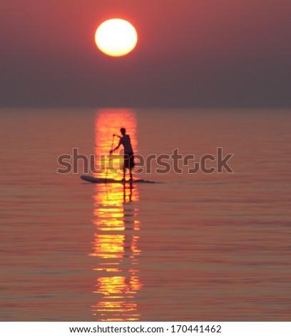 Sunset Paddle - stock photo