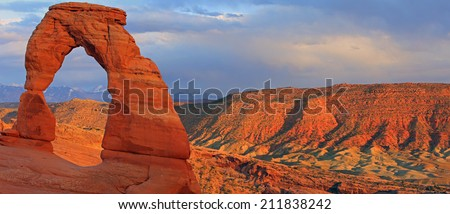 Sunset panorama at Delicate Arch, Arches National Park, Utah, USA. - stock photo