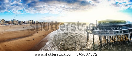 Sunset panorama of  the Hague's pier in Scheveningen , autumn and sunset