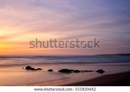 Sunset panorama on the beach, sea on background, long exposure shot