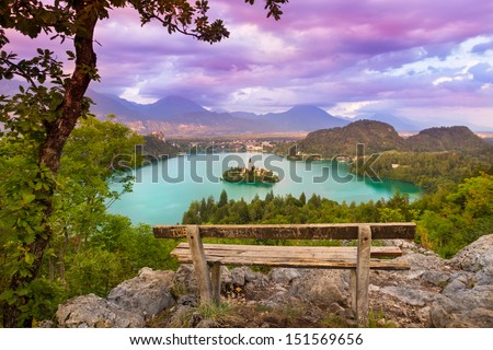 Sunset panoramic view of  Julian Alps, Lake Bled with St. Marys Church of the Assumption on the small island; Bled, Slovenia, Europe. - stock photo