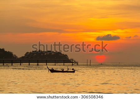 Sunset Patong Beach, Thailand. Was the scene of a cloudy orange.