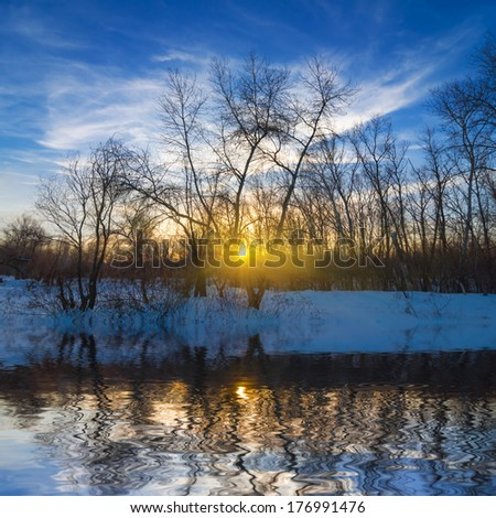 sunset reflected in a lake - stock photo