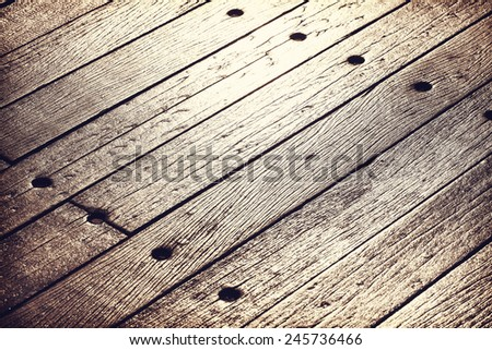 Sunset reflected on old, grunge wood panels, texture or background. - stock photo