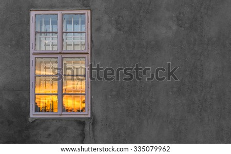 Sunset reflecting in the window.