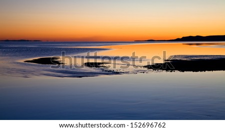 Sunset reflecting off a calm Great Salt Lake - stock photo