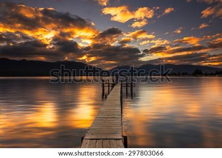 Sunset reflection at a jetty by Lake Te Anau, New Zealand - stock photo