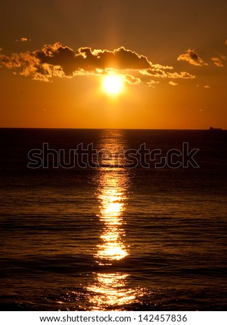 Sunset reflection over the Indian Ocean in Perth, Western Australia.