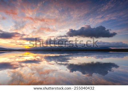 Sunset reflections in Hvalfjordur, South Iceland/ Fjord sunset - stock photo