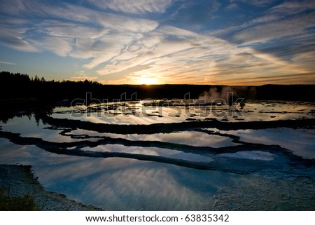 Sunset reflections on Great Fountain geyser in Yellowstone N.P.