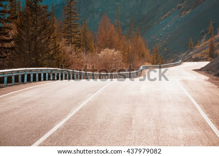sunset road curves in mountains - stock photo
