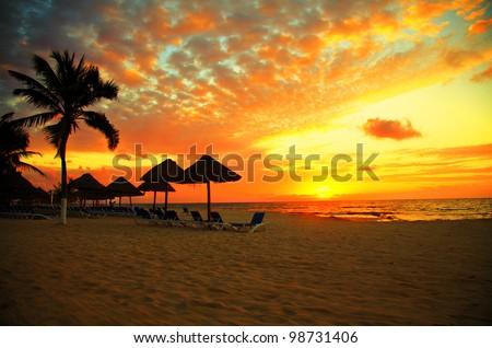 Sunset Scene at Tropical Beach Resort Silhouette - stock photo