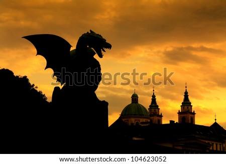 Sunset scene of Green Dragon on the Dragon Bridge in capital city Ljubljana, Slovenia. The Dragon Bridge designed by the architect Jurij Zaninovi?, was erected in 1901 - stock photo