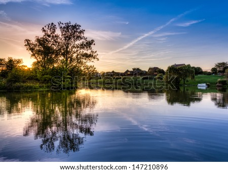 Sunset scene on a small lake in Central Kentucky - stock photo