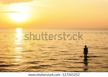 sunset scenery and girl - stock photo