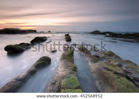 Sunset seascape at Kudat Sabah Malaysia. image taken with long exposure may lead to visible noise, blur or soft focus on the image.  - stock photo