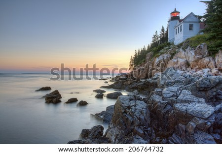 Sunset shot of Bass Harbor Lighthouse, located in Acadia National Park, Maine.  - stock photo