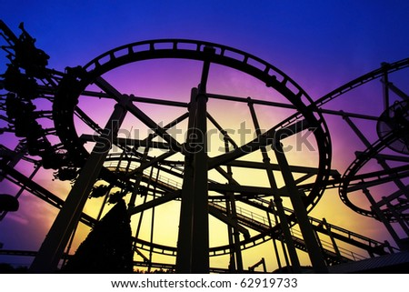 Sunset silhouette of a rollercoaster - stock photo