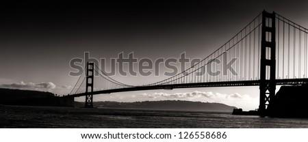 Sunset Silhouette  Panoramic View of the Golden Gate Bridge. - stock photo