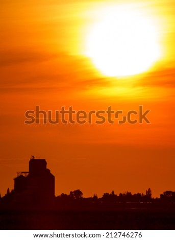 Sunset Sillouette with Grain Elevator and Pense Saskatchewan - stock photo