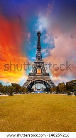 Sunset sky above Eiffel Tower - Paris. La Tour Eiffel from Champs de Mars. - stock photo