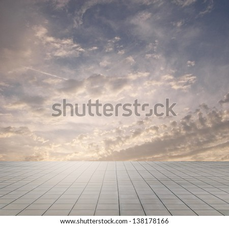 sunset sky and grey floor, bright background - stock photo