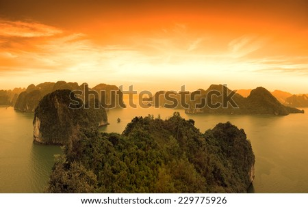 Sunset sky and mountains rocks of Halong Bay Vietnam - stock photo