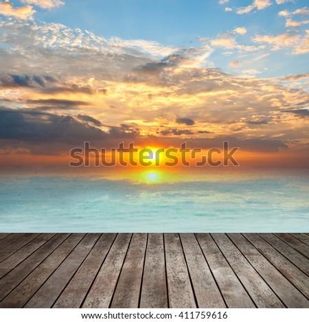 sunset sky and wood floor - stock photo