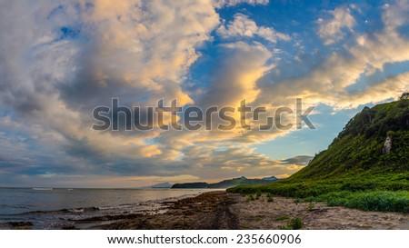 Sunset sky at the Pacific ocean coast, Kunashir island, Russia - stock photo