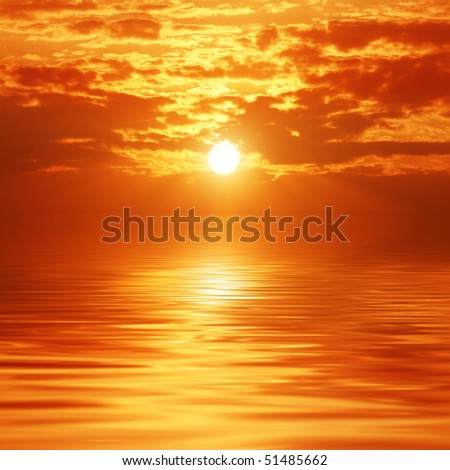 Sunset sky reflection over a sea. - stock photo
