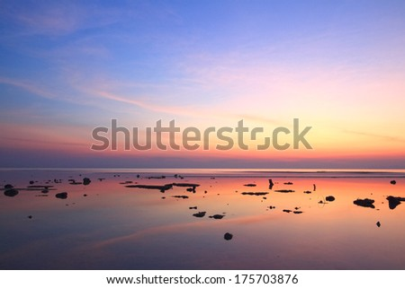Sunset sky reflection over clear sea  - stock photo
