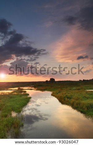 Sunset sky under river in spring - stock photo
