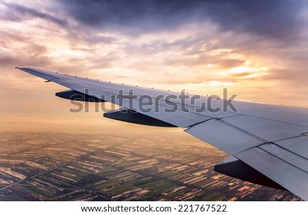 Sunset sky view over the wing of the plane - stock photo