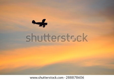 Sunset sky with airplane silhouette - stock photo